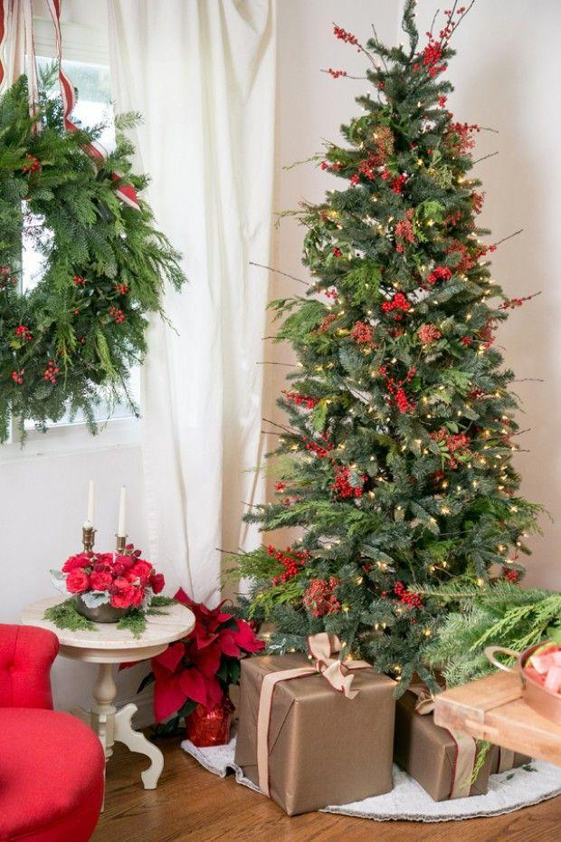 "<p>Keep it simple and decorate your tree with a few sprigs of red berries. It will add an earthy, fresh look to your living room.</p><p>See more at <a href=""https://sugarandcharm.com/2014/12/charming-christmas-brunch.html?section-5"" rel=""nofollow noopener"" target=""_blank"" data-ylk=""slk:Sugar and Charm"" class=""link rapid-noclick-resp"">Sugar and Charm</a>.</p><p><a class=""link rapid-noclick-resp"" href=""https://www.amazon.com/IFOYO-Berries-Artificial-Christmas-Decorations/dp/B0761LQB7T/?tag=syn-yahoo-20&ascsubtag=%5Bartid%7C10057.g.505%5Bsrc%7Cyahoo-us"" rel=""nofollow noopener"" target=""_blank"" data-ylk=""slk:SHOP BERRIES"">SHOP BERRIES</a><em><strong> Berry Stems, $10</strong></em><br></p>"