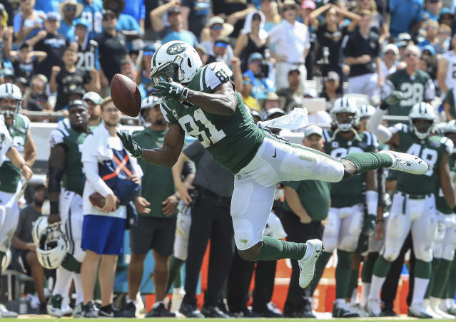 <p>Quincy Enunwa #81 of the New York Jets attempts to make a catch during the first half against the Jacksonville Jaguars at TIAA Bank Field on September 30, 2018 in Jacksonville, Florida. (Photo by Sam Greenwood/Getty Images) </p>