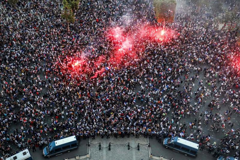 Fans in Paris celebrate winning the World Cup (AFP/Getty Images)