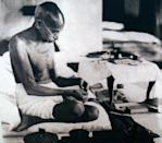 Mahatma Gandhi spinning homespun cloth during a protest against British Rule in India. (Photo by: Universal History Archive/ Universal Images Group via Getty Images)