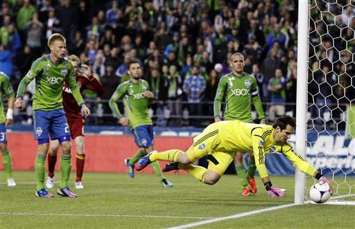 Seattle Sounders goalkeeper Michael Gspurning dives for a ball in the second half of an MLS soccer match against Real Salt Lake, Wednesday, Oct. 17, 2012, in Seattle. The teams played to a 0-0 tie. (AP Photo/Ted S. Warren)
