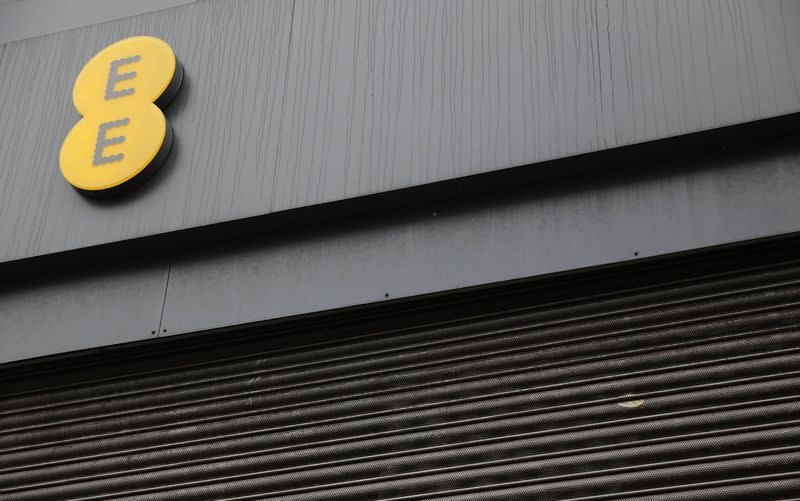 A closed EE shop is seen in London