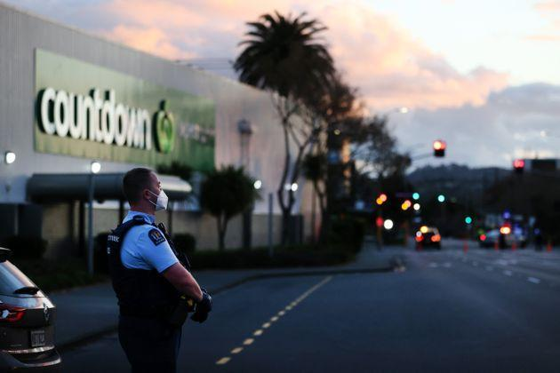 Police standing outside the supermarket where the stabbings occurred on Friday (Photo: Fiona Goodall via Getty Images)
