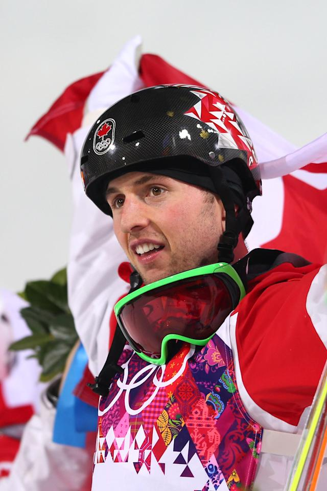 SOCHI, RUSSIA - FEBRUARY 10: Gold medalist Alex Bilodeau of Canada celebrates during the flower ceremony for the Men's Moguls Finals on day three of the Sochi 2014 Winter Olympics at Rosa Khutor Extreme Park on February 10, 2014 in Sochi, Russia. (Photo by Mike Ehrmann/Getty Images)