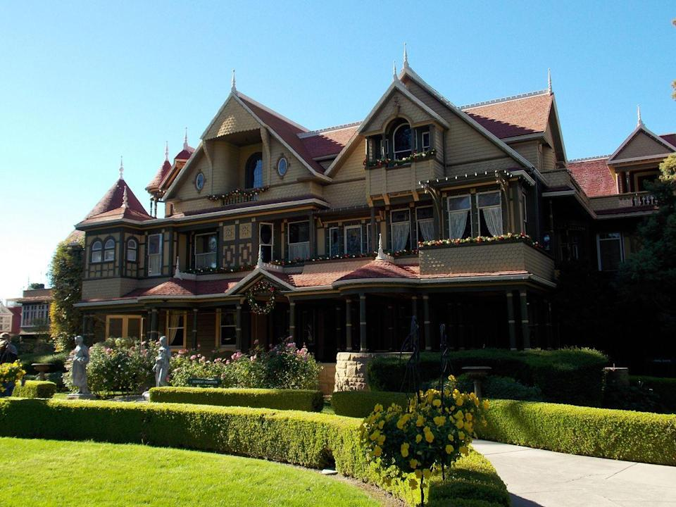 "<p>If you're a fan of unique architecture, this is a must-see. The stately mansion is a historic landmark in San Jose, California. <a href=""https://winchestermysteryhouse.com/"" rel=""nofollow noopener"" target=""_blank"" data-ylk=""slk:Built by Sarah Winchester"" class=""link rapid-noclick-resp"">Built by Sarah Winchester</a>, the widow of firearm creator William Wirt Winchester. Sarah felt haunted by the spirits killed by Winchester rifles, and to keep them at bay, she had construction workers building around the clock for almost 40 years. The construction was so haphazard that there's a door to nowhere and windows that look into other rooms.<br></p>"
