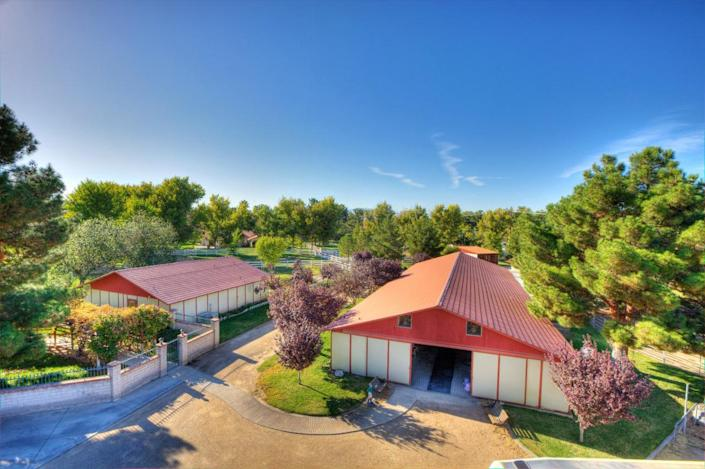 """<p>World-class equestrian facilities include stables with indoor and outdoor stalls, and a two-stall horse wash bay. (All photos via <a href=""""http://bit.ly/1OjQdjg"""" rel=""""nofollow noopener"""" target=""""_blank"""" data-ylk=""""slk:Concierge Auctions listing"""" class=""""link rapid-noclick-resp"""">Concierge Auctions listing</a>)</p>"""