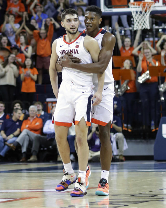 Virginia guard De'Andre Hunter, behind, celebrates a three-point play by teammate Ty Jerome (11) during an NCAA basketball game Tuesday, Nov. 6, 2018, in Charlottesville, Va. Virginia defeated Towson 73-42. (AP Photo/Andrew Shurtleff)