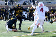 Missouri place kicker Harrison Mevis (92) kicks a 32-yard field goal to defeat Arkansas 50-48 on the final play of an NCAA college football game Saturday, Dec. 5, 2020, in Columbia, Mo. (AP Photo/L.G. Patterson)