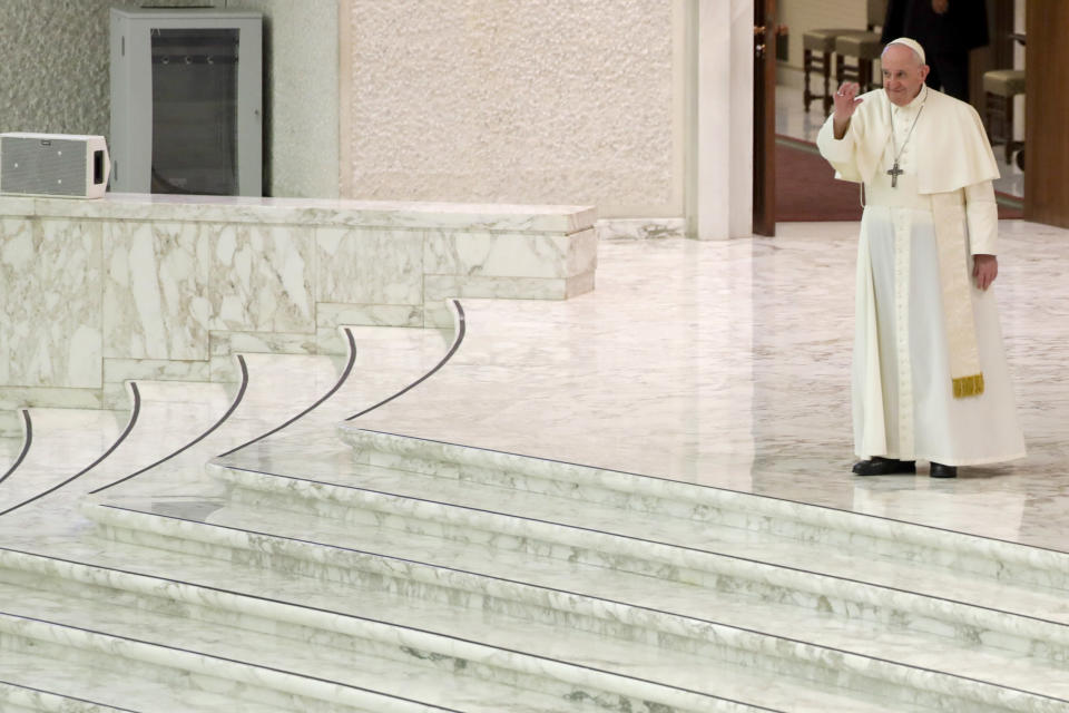 Pope Francis arrives for his weekly general audience in the Pope Paul VI hall at the Vatican, Wednesday, Oct. 14, 2020. (AP Photo/Andrew Medichini)