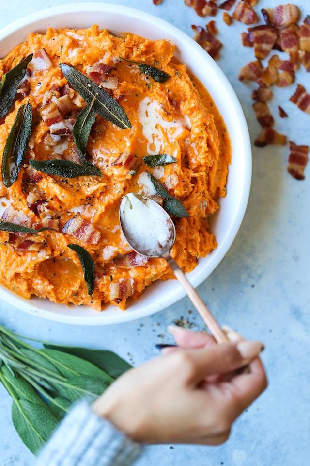 """<p>Sage butter? Check. Crisp bacon bits? Check. Yup, we're in heaven.</p><p><strong>Get the recipe at <a href=""""https://damndelicious.net/2018/11/06/mashed-sweet-potatoes"""" target=""""_blank"""">Damn Delicious</a>. </strong></p><p><strong><strong><a class=""""body-btn-link"""" href=""""https://www.amazon.com/Best-Sellers-Kitchen-Dining-Baking-Dishes/zgbs/kitchen/3737211?tag=syn-yahoo-20&ascsubtag=%5Bartid%7C10050.g.2696%5Bsrc%7Cyahoo-us"""" target=""""_blank"""">SHOP BAKING DISHES</a></strong><br></strong></p>"""