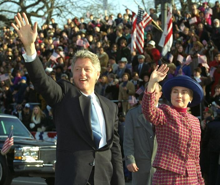 <p>President and Mrs. Clinton wave as they walk down Pennsylvania Avenue in Washington, D.C., on Jan. 20, 1993, during the presidential inaugural parade. (Photo: Doug Mills/AP)</p>