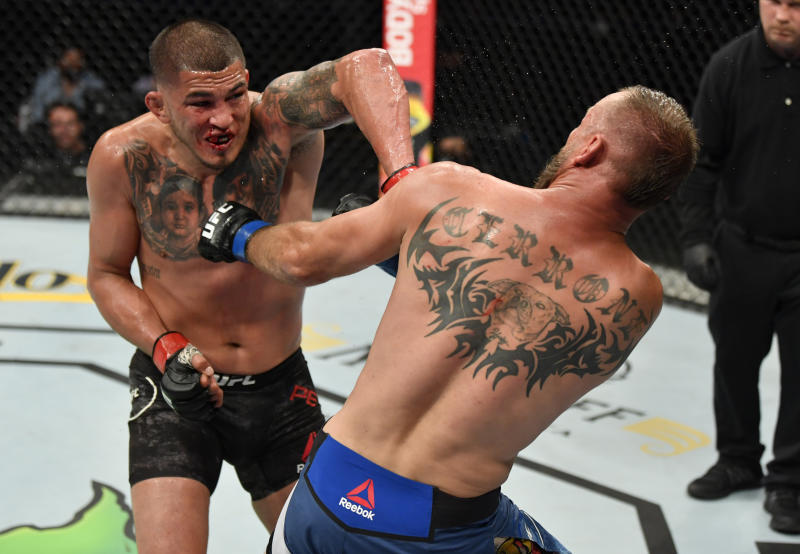 Anthony Pettis punches Donald Cerrone in their welterweight fight during UFC 249 at VyStar Veterans Memorial Arena on May 09, 2020, in Jacksonville, Florida.