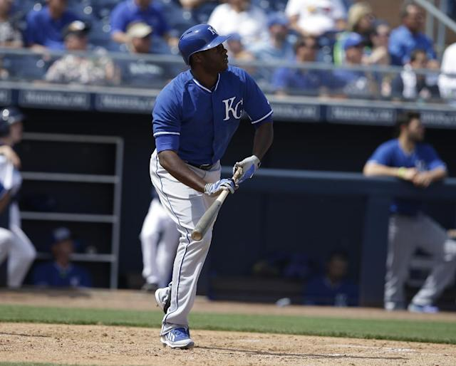 Kansas City Royals' Lorenzo Cain hits during a spring exhibition baseball game against the San Diego Padres Wednesday, March 26, 2014, in Peoria, Ariz. (AP Photo/Darron Cummings)