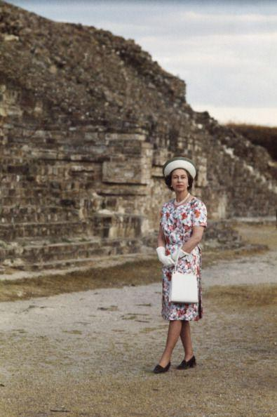 <p>A young Queen Elizabeth posed in a pink- and red-flowered dress paired with matching white accessories while on a 1975 trip to Mexico. </p>