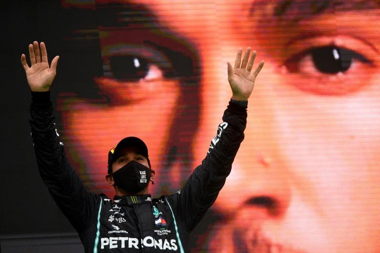 Better than the rest: Lewis Hamilton celebrates on the podium after winning the Portuguese Grand Prix last week