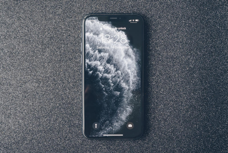Apple iPhone 11 Pro on luxury dark background