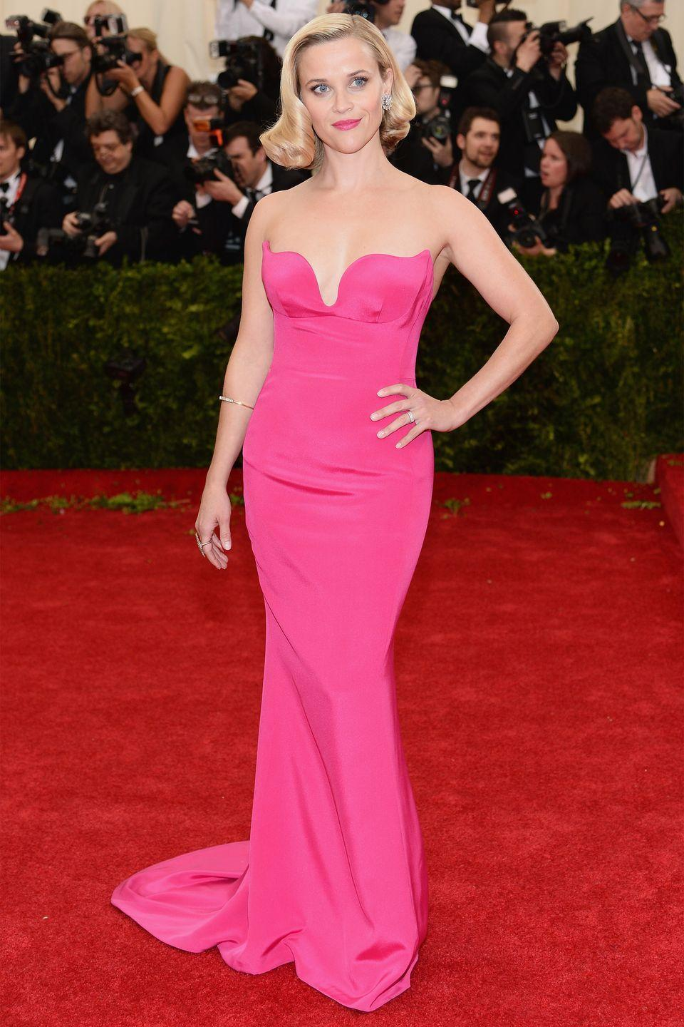 <p>Witherspoon brought the va-va-voom in a hot pink Stella McCartney gown at the annual Costume Institute Gala where she attended with the British designer. </p>