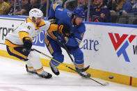 Nashville Predators' Dan Hamhuis (5) and St. Louis Blues' Jacob De La Rose (61) chase the puck during the second period of an NHL hockey game Saturday, Nov. 23, 2019, in St. Louis. (AP Photo/Dilip Vishwanat)