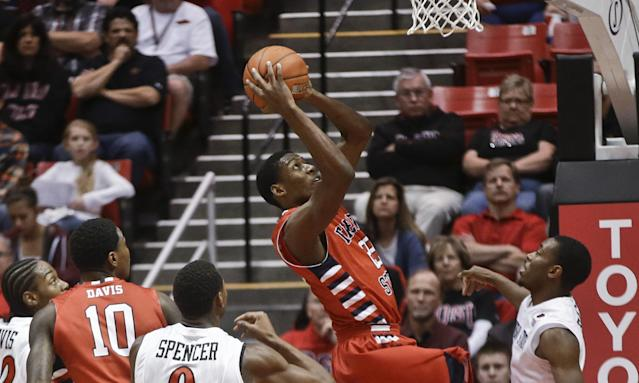 Fresno State's Paul Watson splits the San Diego State defense while scoring during the first half of a NCAA college basketball game Wednesday, Jan. 15, 2014, in San Diego. (AP Photo/Lenny Ignelzi)
