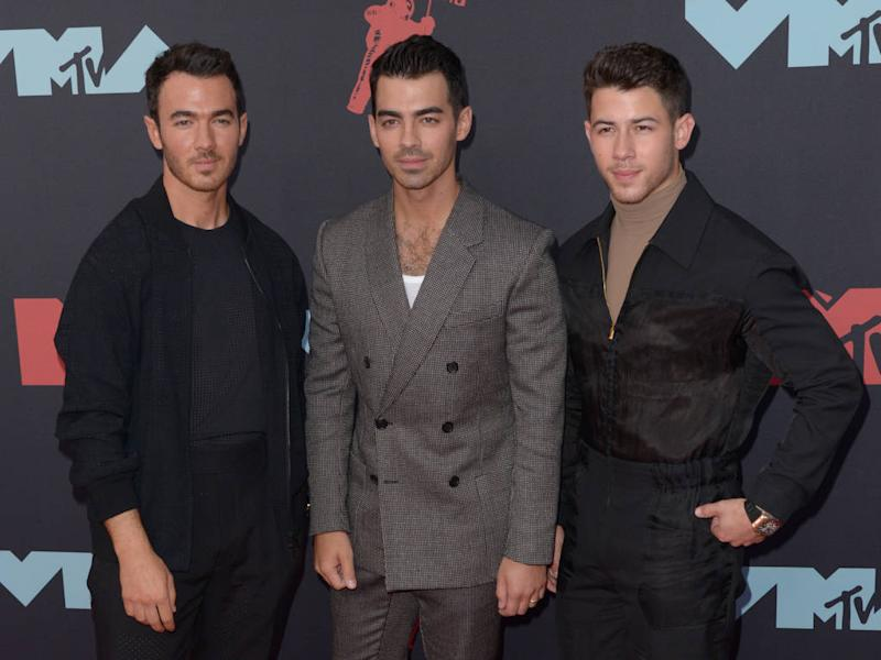 Jonas Brothers surprise critically ill super fan with hospital visit