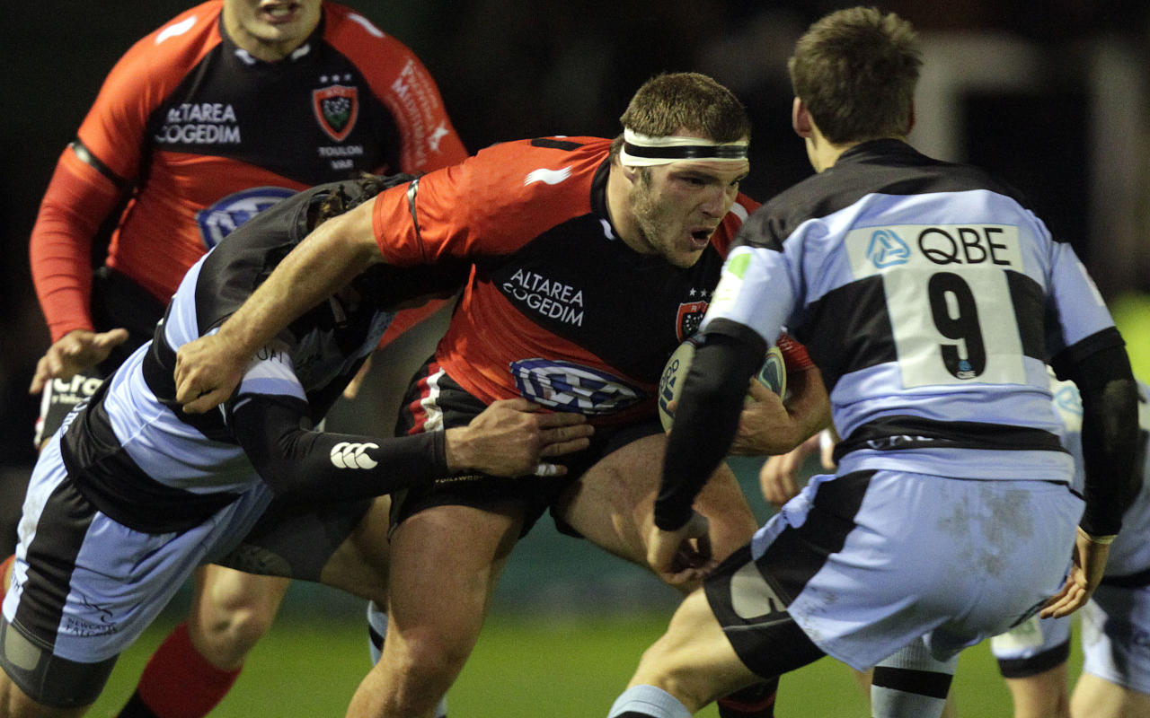 Newcastle Falcons' Ryan Shortland (L) and Jordi Pasqualin (R) tackles Toulon's Jean-Charles Orioli (2R) during a pool 2, European Challenge Cup rugby union match at Kingston Park, Newcastle upon Tyne on December 8, 2011. AFP PHOTO/GRAHAM STUART (Photo credit should read GRAHAM STUART/AFP/Getty Images)