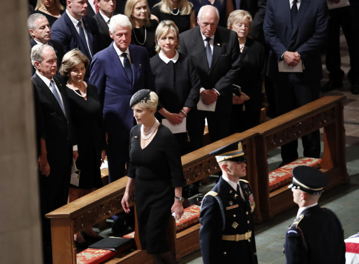Cindy McCain arrives at a memorial service for her husband, Sen. John McCain, R-Ariz., at the Washington National Cathedral in Washington, Saturday, Sept. 1, 2018. McCain died Aug. 25, from brain cancer at age 81. Watching in the front row from left are President George W. Bush, former first lady Laura Bush, former President Bill Clinton, former Secretary of State Hillary Clinton, former Vice President Dick Cheney and his wife Lynne. (AP Photo/Pablo Martinez Monsivais)