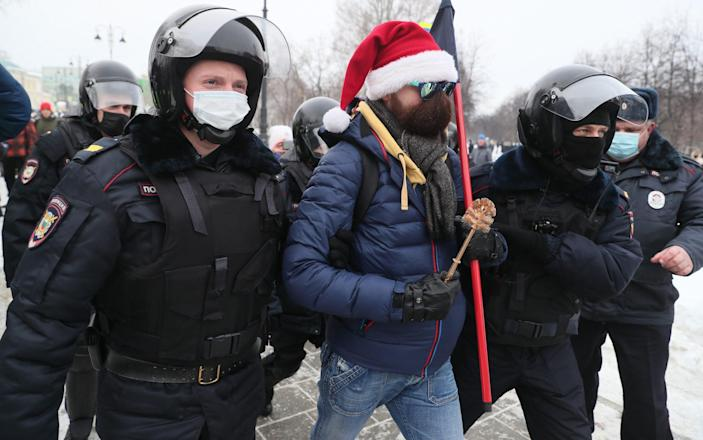 Police officers detain a demonstrator during an unauthorised protest in support of the detained opposition activist Alexei Navalny in Ploshchad Kommunarov Square - TASS