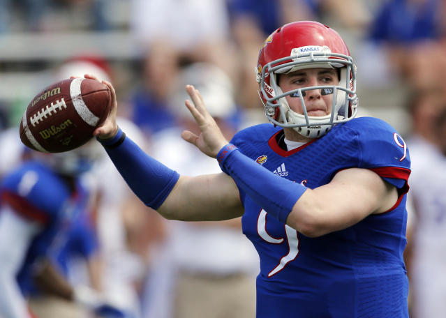 Kansas quarterback Jake Heaps passes to a receiver during the second half of an NCAA college football spring game in Lawrence, Kan., Saturday, April 12, 2014. (AP Photo/Orlin Wagner)