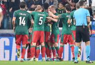 Lokomotiv Moscow celebrate after scoring a goal during the UEFA Champions League group D soccer match against Juventus FC at the Allianz Stadium in Turin, Italy, Tuesday, Oct. 22, 2019. (Alessandro Di Marco/ANSA via AP)