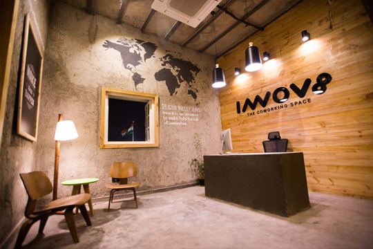 Reception area with a hand carved map of the silicon valleys of the world.