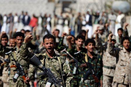 Houthi militants take part in a parade held to mark 1000 days of the Saudi-led military intervention in the Yemeni conflict, in Sanaa, Yemen