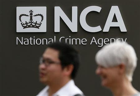 Pedestrians walk past the National Crime Agency (NCA) headquarters in London October 7, 2013. REUTERS/Stefan Wermuth