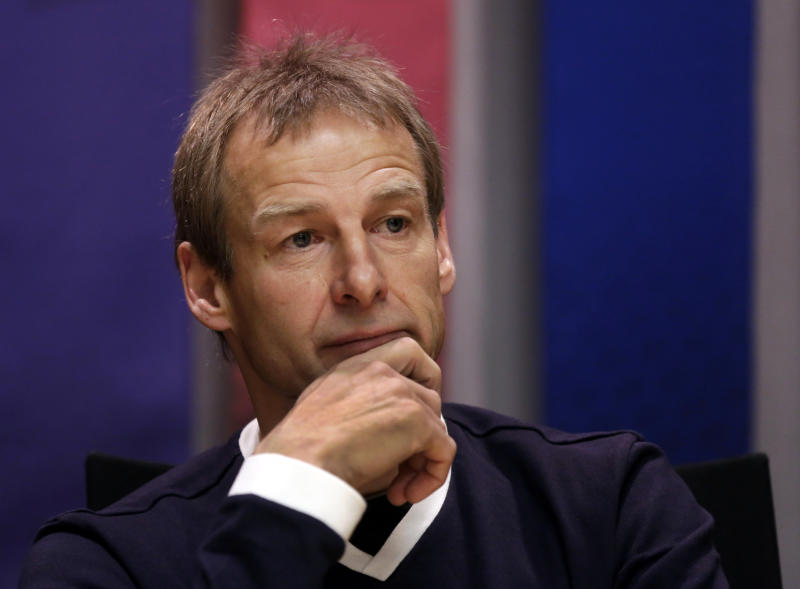 "U.S. Soccer men's national team head coach Jurgen Klinsmann listens during an interview Friday, April 5, 2013, in New York. Tim Howard remains the No. 1 American goalkeeper despite a pair of strong performance by Brad Guzan in World Cup qualifiers last month. Speaking Friday as the U.S. Soccer Federation marked its 100th anniversary, Klinsmann said ""Tim is No. 1 undoubtedly."" Klinsmann added, however, that he's pleased to see Guzman making a breakthrough and starting at Aston Villa. The coach says ""the level he played those two games just makes you feel a lot better now having such a strong No. 2."" (AP Photo/Richard Drew)"
