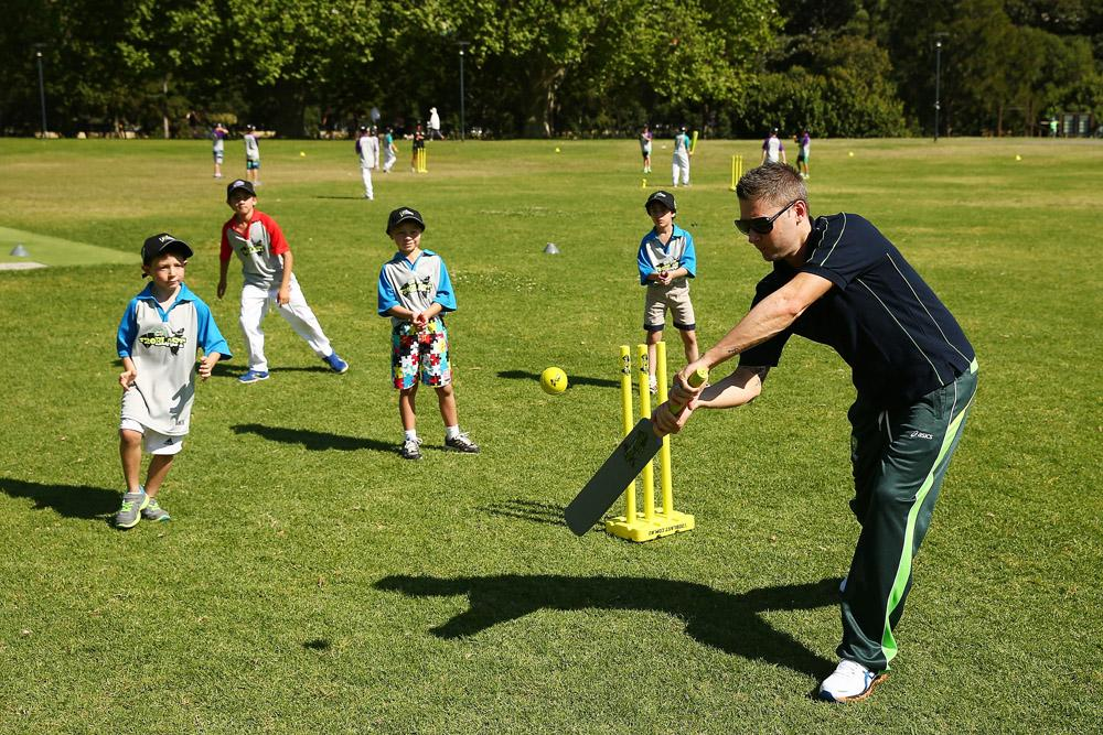 Australia captain Michael Clarke plays cricket with young participants during the launch for Cricket Australia's junior sports program MILO T20 Blast at Rushcutters Bay Park on September 25, 2013 in Sydney, Australia.  (Photo by Matt King/Getty Images)