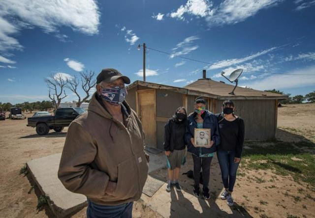 Emerson Gorman (L), who is a Navajo elder, poses at his property with his grandchild Nizhoni, wife Beverly and daughter Naiyahnikai near the Navajo Nation town of Steamboat in Arizona (AFP Photo/Mark RALSTON)