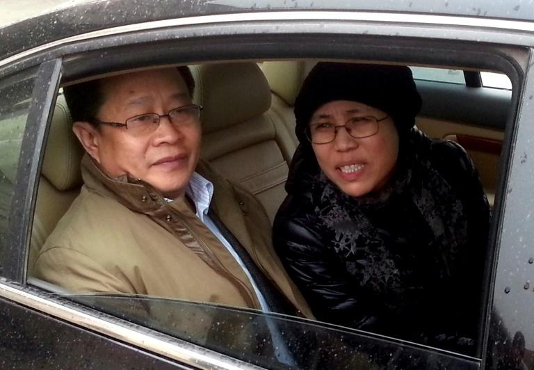 Liu Xiaobo's wife, Liu Xia, is pictured here with human rights lawyer Mo Shaoping at the 2013 trial of her brother, Liu Hui, who was charged with fraud