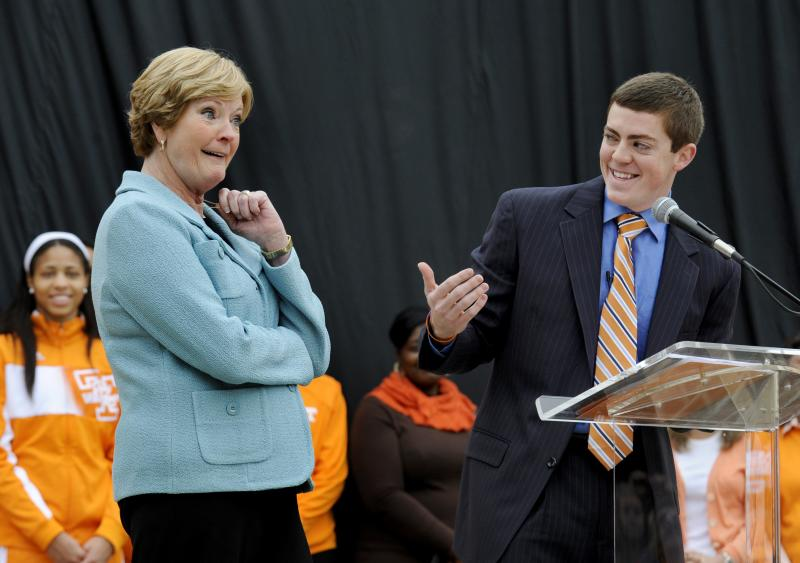 Tennessee women's basketball coach emeritus Pat Summitt, left, laughs with her son, Tyler, during the unveiling of a statue in her honor on on Friday, Nov. 22, 2013, in Knoxville, Tenn. The statue was revealed at a dedication ceremony for the Pat Summitt Plaza to honor the coach who led Tennessee to eight national titles and 18 Final Four appearances. (AP Photo/Knoxville News Sentinel, Michael Patrick)