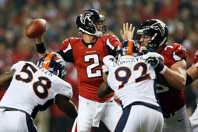 ATLANTA, GA - SEPTEMBER 17: Quarterback Matt Ryan #2 of the Atlanta Falcons looks to throw the ball against outside linebacker Von Miller #58 and defensive end Elvis Dumervil #92 of the Denver Broncos during a game at the Georgia Dome on September 17, 2012 in Atlanta, Georgia. (Photo by Kevin C. Cox/Getty Images)