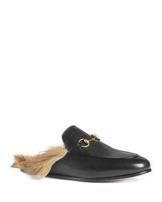 <p><span>Gucci Women's Princetown Leather and Lamb Fur Mules</span> ($995)</p>