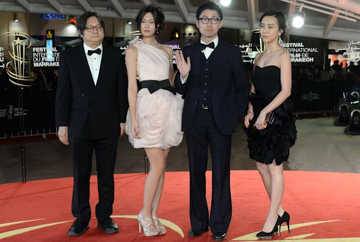 Guest, Ena Koshino, Akuya Misawa and Kiki Sugino arrive on the red carpet for the Tribute to Japanese Cinema during the 14th Marrakesh International Film Festival on December 9, 2014 in Marrakech (AFP Photo/Fadel Senna)