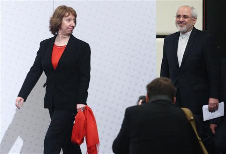 European Union foreign policy chief Catherine Ashton (L) and Iranian Foreign Minister Mohammad Javad Zarif arrive for a press statement after a conference in Vienna February 20, 2014. REUTERS/Heinz-Peter Bader