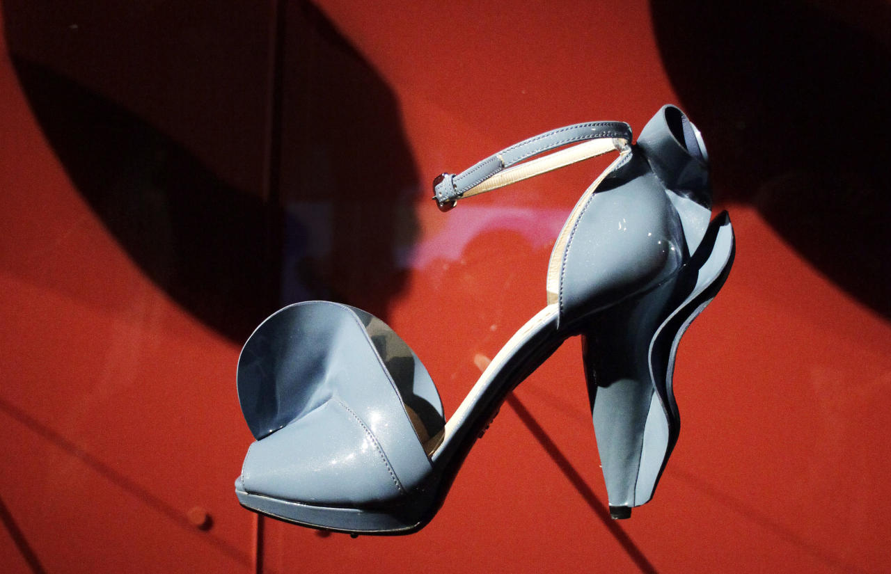 """A shoe designed by Miuccia Prada is displayed at the Metropolitan Museum of Art, Monday, May 7, 2012 in New York. The show """"Schiaparelli and Prada, Impossible Conversations,"""" opens May 10 and continues through Aug. 19. (AP Photo/Mark Lennihan)"""