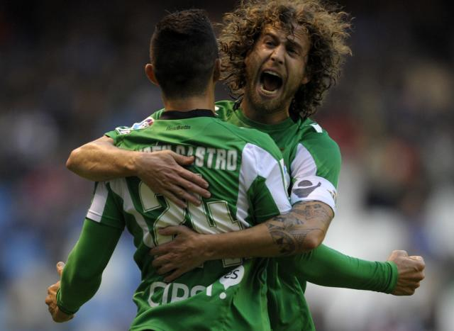 Betis' forward Ruben Castro (L) celebrates with teammate midfielder Jose Canas after scoring a goal during the Spanish league football match Deportivo vs Betis at Riazor's Stadium in Coruna, on December 2, 2012. AFP PHOTO / MIGUEL RIOPAMIGUEL RIOPA/AFP/Getty Images