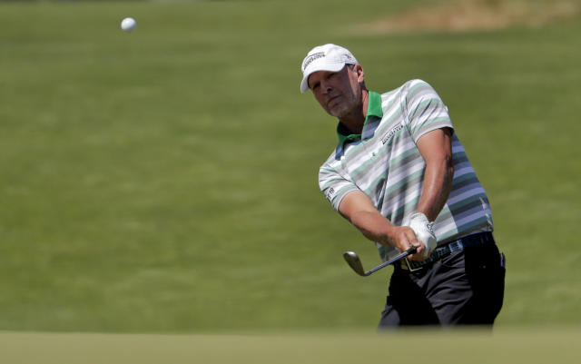 Steve Stricker plays a shot from the fifth hole during the third round of the U.S. Open Golf Championship, Saturday, June 16, 2018, in Southampton, N.Y. (AP Photo/Julio Cortez)