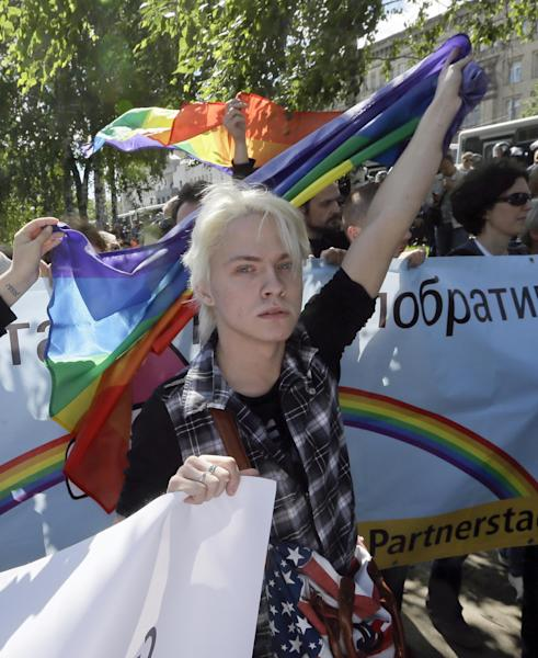 Activists in Ukraine's first gay pride demonstration during the action in Kiev, Ukraine, Saturday, May 25, 2013. About a hundred gay and lesbian Ukrainian and those from other countries took part in the gay pride rally, protected by hundreds of riot police. Antipathy toward homosexuals remains strong in Ukraine. (AP Photo/Efrem Lukatsky)