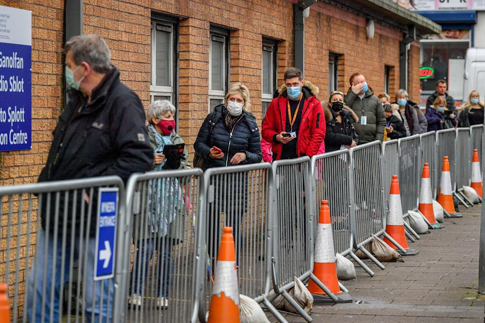 People wait for Covid vaccination (PA Wire)