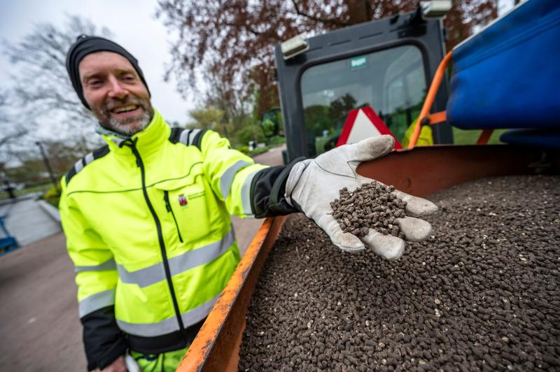 Garden worker Robert Nilsson presents some chicken manure to fertilize lawns in the Stadsparken park in Lund, Sweden, on April 30, 2020, amid the novel coronavirus COVID-19 pandemic. - It's an attempt to aviod residents from gathering there for the traditional celebrations to mark Walpurgis Night. (Photo by Johan NILSSON / TT News Agency / AFP) / Sweden OUT (Photo by JOHAN NILSSON/TT News Agency/AFP via Getty Images)