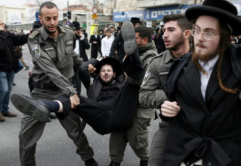Israeli police arrest ultra-Orthodox Jews during a protest against conscription in an ultra-Orthodox neighbourhood of Jerusalem on February 9, 2017