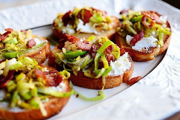 """<p>For a spring-inspired appetizer, try this leek and bacon bruschetta. Both savory ingredients pair nicely with the creamy, tart goat cheese.</p><p><a href=""""https://www.thepioneerwoman.com/food-cooking/recipes/a11413/bruschetta-with-leeks-goat-cheese-and-bacon/"""" rel=""""nofollow noopener"""" target=""""_blank"""" data-ylk=""""slk:Get the recipe."""" class=""""link rapid-noclick-resp""""><strong>Get the recipe.</strong></a></p><p><a class=""""link rapid-noclick-resp"""" href=""""https://go.redirectingat.com?id=74968X1596630&url=https%3A%2F%2Fwww.walmart.com%2Fsearch%2F%3Fquery%3Dpioneer%2Bwoman%2Bcutting%2Bboards&sref=https%3A%2F%2Fwww.thepioneerwoman.com%2Ffood-cooking%2Fmeals-menus%2Fg35585877%2Feaster-recipes%2F"""" rel=""""nofollow noopener"""" target=""""_blank"""" data-ylk=""""slk:SHOP CUTTING BOARDS"""">SHOP CUTTING BOARDS</a></p>"""