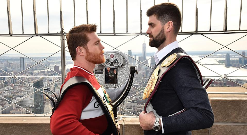 Canelo Alvarez and Rocky Fielding show off their belts at The Empire State Building because no other venue was available for the promotional shoot on that day in New York City. (Photo by Theo Wargo/Getty Images)
